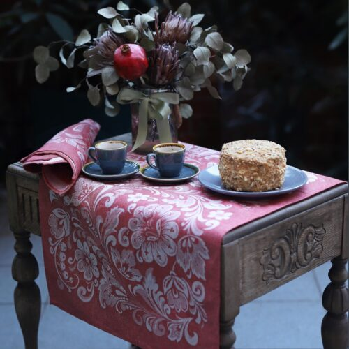 Lilly Jacquard Tea Towel on the wooden table