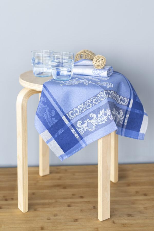 Helga-Jacquard-Tea-Towel-Blue-on-the-stool