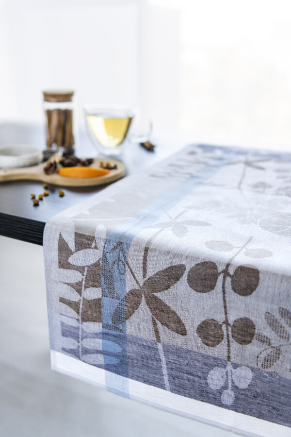 Autumn Garden Jacquard Tea Towel close look with spices and tea on the table