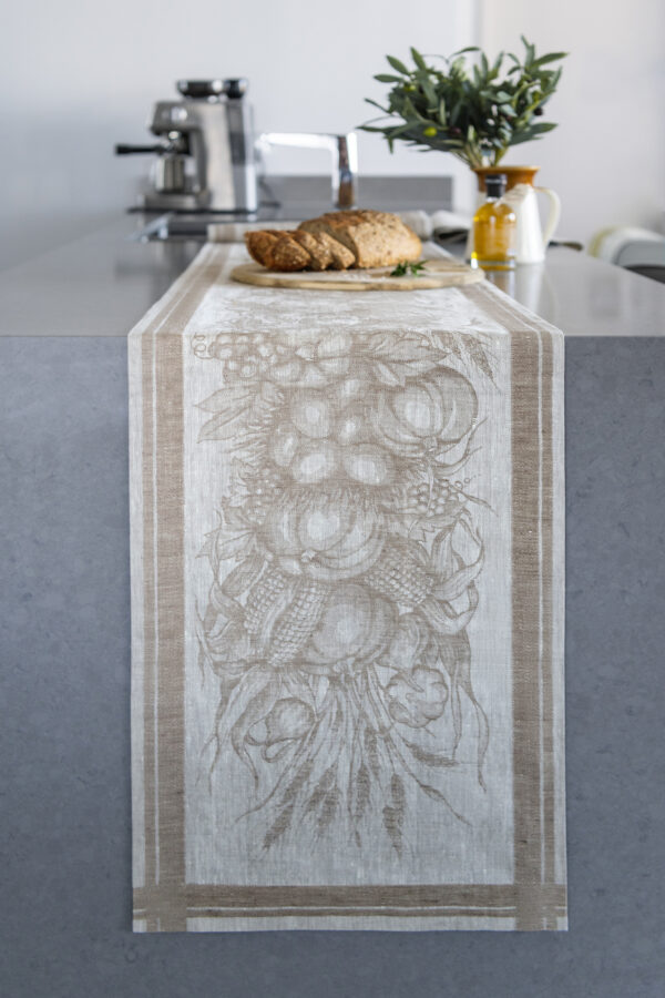 Autumn Harvest Table Runner on the kitchen bench with pumpkins and Olives