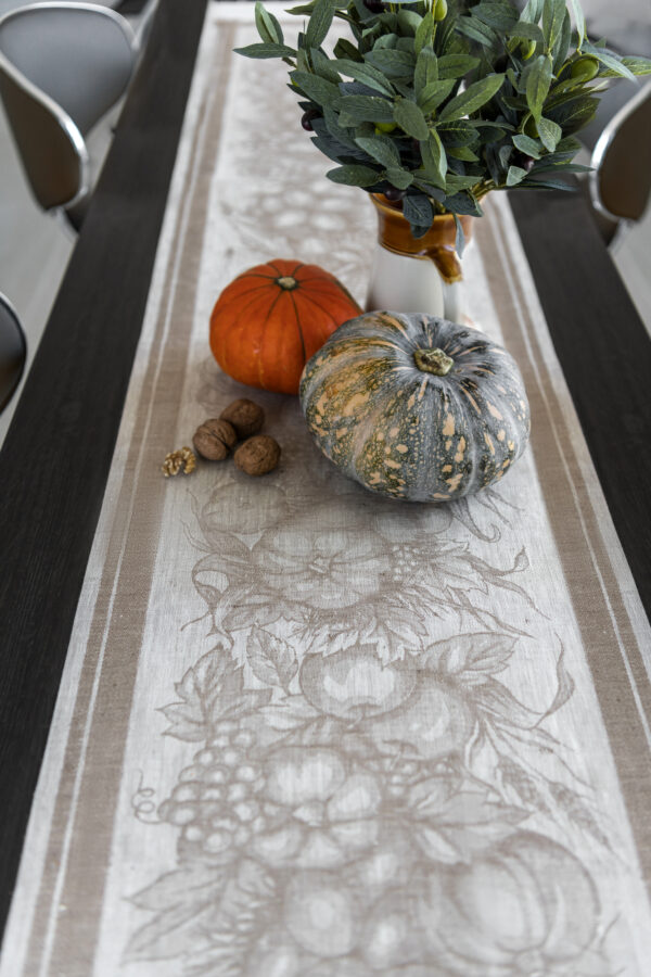 Autumn Harvest Table Runner on the table with pumpkins and Olives