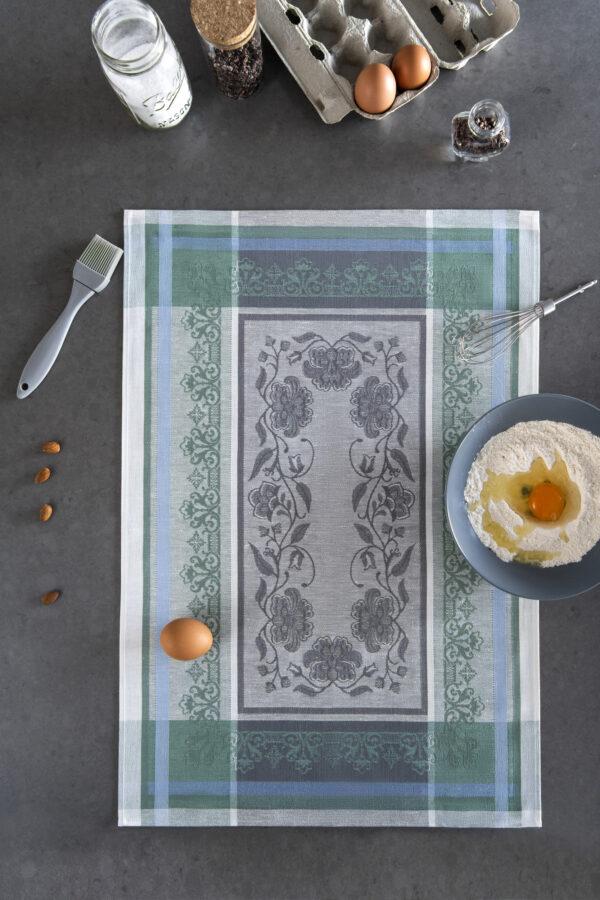 Felicity Jacquard Tea Towel flat on marble with eggs and flour