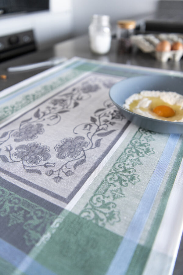 Felicity Jacquard Tea Towel flat on marble with eggs and flour close look