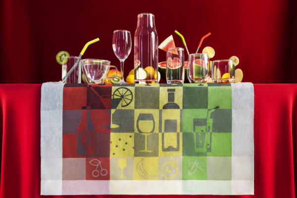 Party Time Jacquard Tea Towel with Glass and Fruit on red